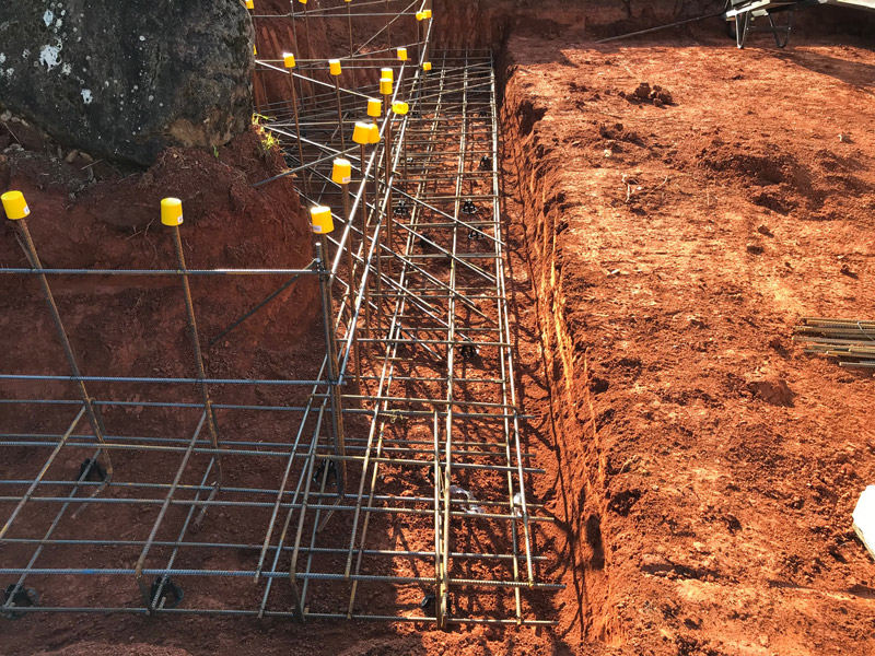 This is a footing inspection for a retaining wall in rich red soil.