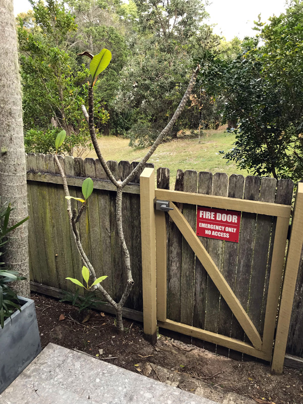 This timber paling boundary fence is a 'fire door'.